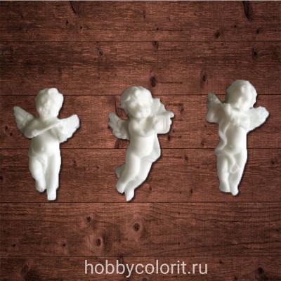 Декор из пластика, набор ангелочков, примерный размер 1,6х3,0 см